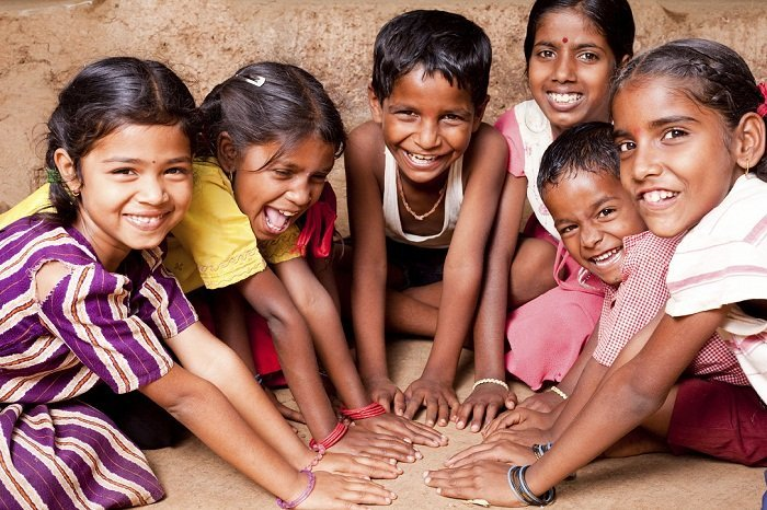Group of Cheerful Rural Indian Children joining hands