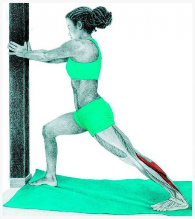 Standing calf stretch at the wall